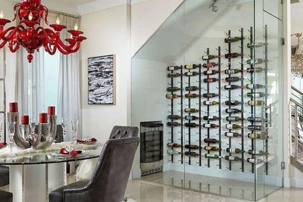 Looking at a wine room enclosed in SMI-45 Aldora glass. Beyond the room are stairs, furniture and a patio door